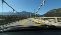 Crossing suspension bridge in Revelstoke, BC. Stock Footage