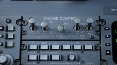 Engine control panel inside cockpit of commercial airline Stock Footage
