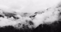 4k timelapse mountain mist rising in the morning,fog trees,Bomi County,tibet. - stock footage