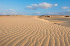 waves on sand dunes  in chaves beach praia de chaves in boavista island cape  - stock photo