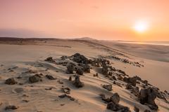 Sunset on sand dunes  in chaves beach praia de chaves in boavista island cape Stock Photos