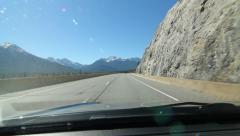 Rocky Mountain rockface. Sunny drive in Alberta, Canada. Stock Footage
