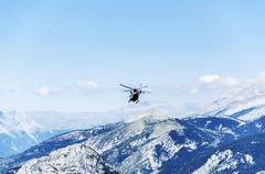 Chopper of guardia civil patrulling over the mountain in spain Stock Photos