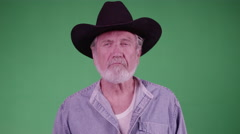 A Tired Farmer Sighs And Looks Depleted (Green Screen). Stock Footage