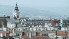 Rooftops 003 in foggy winter with chimneysmoke in vienna Stock Footage