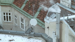 Rooftops 002 covered with snow with chimney smoke in vienna Stock Footage