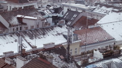 Rooftops 006 in winter foggy covered with snow in vienna Stock Footage