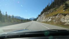 Sunny drive through the Rockies. Just west of Banff, Alberta. - stock footage
