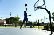 Stock Photo of Basketball Dunk Outdoors