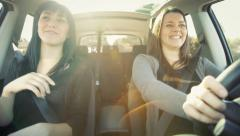 Stock Video Footage of Two happy female friends driving car excited about going in vacation