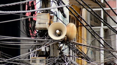 Zoom Out of Propaganda Loudspeaker on Telephone Pole - Ho Chi Minh City - stock footage