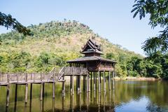 Scripture hall in the pond, thailand. Stock Photos
