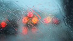 sleet and rain drops on the windshield ,bokeh - stock footage