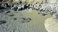 Secluded rocky beach Stock Footage