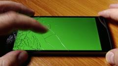 Broken Screen Smartphone with Green Background 1 Stock Footage