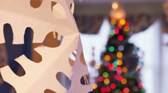 2704 Paper Snow Flake with Christmas Tree Behind, 4K   - stock footage