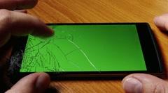 Broken Screen Smartphone with Green Background 3 Stock Footage