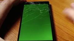 Broken Screen Smartphone with Green Background 4 Stock Footage