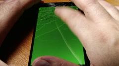Broken Screen Smartphone with Green Background 5 Stock Footage
