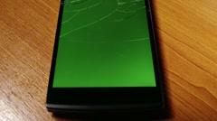 Broken Screen Smartphone with Green Background 6 Stock Footage