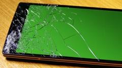 Broken Screen Smartphone with Green Background 10 Stock Footage