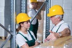 Storage workers in warehouse Kuvituskuvat