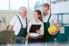 Supervision in manufacturing centre Stock Photos