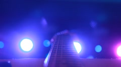 Rock concert: backstage: guitar on the background of stage lighting Stock Footage