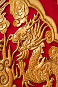Nonthaburi-thailand -december 27 : golden dragon decorated on red wood wall,c Stock Photos