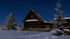 Time lapse HD of stars over timber house at winter night Stock Footage