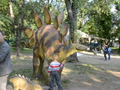 Dinosaur in park. Related clips are in my portfolio in 1920x1080. - stock footage
