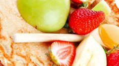 Baked food and fruits : pancake with honey and strawberries Stock Footage