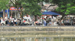 People on the Banks of Hoan Kiem Lake - Hanoi Vietnam Stock Footage