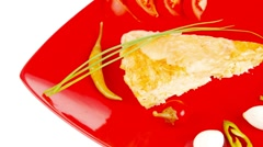 Cheese casserole piece on red plate Stock Footage