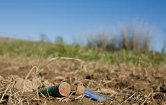 Rusty spent shotgun cartridges Stock Photos