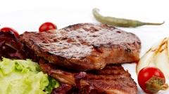Meat food : two roast steak Stock Footage