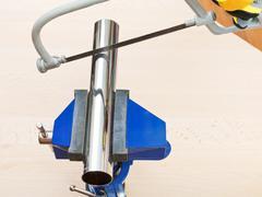 hacksaw saws chrome plated plumbing drain pipe - stock photo
