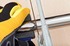 plumber sawing drain pipe close up - stock photo