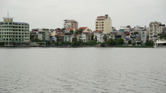 Hanoi Vietnam - Colorful Apartment Buildings on a Scenic Lake Stock Footage