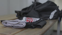 In the locker room of the bag to put clothes for sports Stock Footage