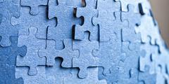 Backside of blue puzzle jigsaw - stock photo