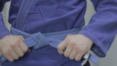 Tie a belt on a kimono Stock Footage