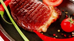Meat entree : grilled beef steak served with hot cayenne peppers Stock Footage