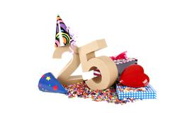 number of age in a colorful studio setting with paper party hats, a red heart - stock photo