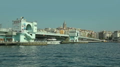 Istanbul ship passes under the Galata bridge - stock footage