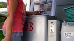 Female Hand Putting Money into the Laundry Machine Stock Footage