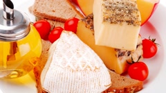 Old cheeses with oil and bread Stock Footage