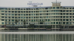 Zoom Out The Hanoi Club Hotel Reflects on the Lake - Hanoi Vietnam Stock Footage