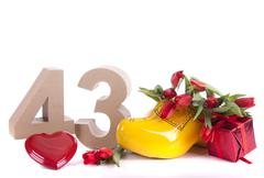 number of age in a colorful studio setting and dutch looking attributes like - stock photo