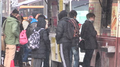 Chinese university and college students at food truck on campus for Asian food Stock Footage